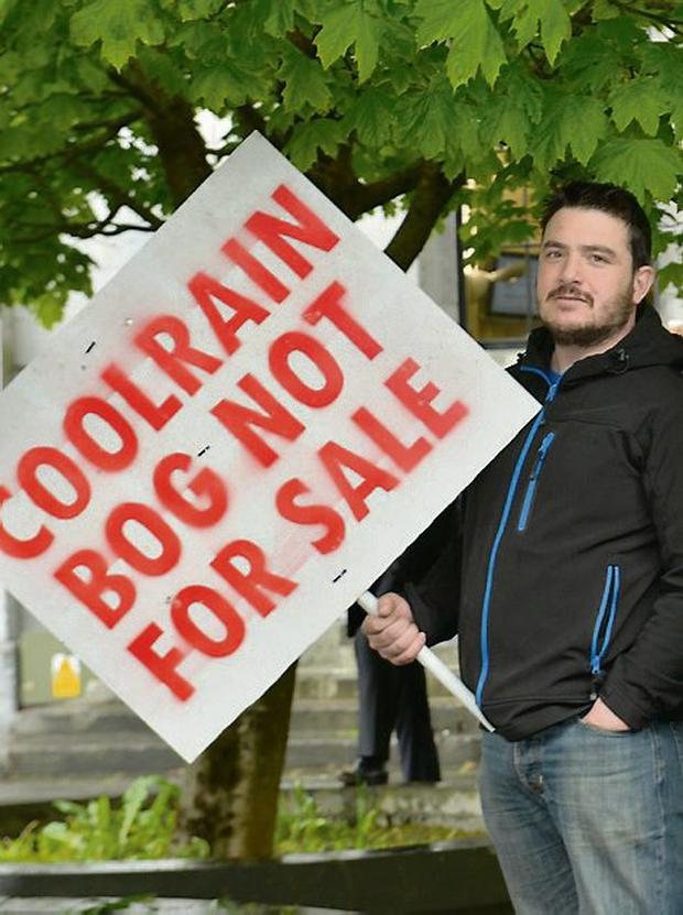 A protester outside court in Galway