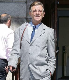 Pearse Brannigan leaves court after settling his case