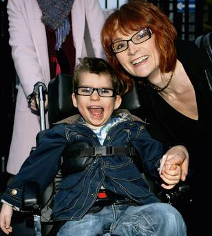 Emily Miggin with her son, Luke, who two years ago was awarded €1.35m over medical negligence.