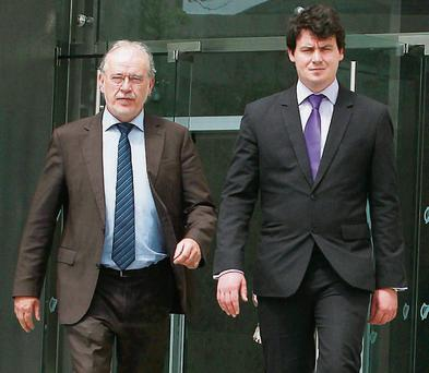Don Ryan, the father of student Eoin, leaves court with his son Daniel