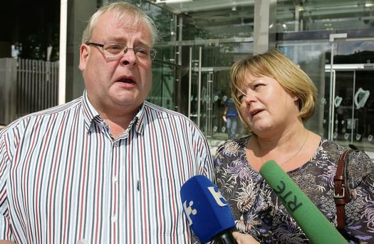 Michael and Martina White, the parents of 15-year-old schoolboy Michael who was killed in the April 2006 bus crash, speak to the media outside Dublin Circuit Criminal Court after the verdict