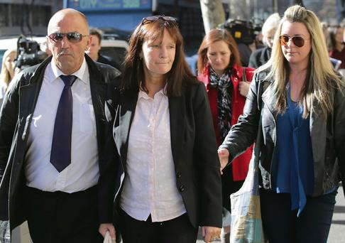 Grieving parents Aidan and Catherine Greene leave the Supreme Court in Melbourne with Lisa Murphy, the best friend of David Greene, who was travelling with him in Australia when he was murdered last year