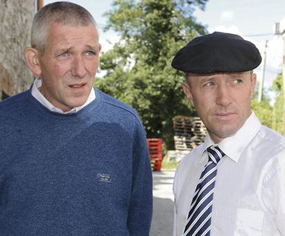 Michael Healy-Rae (right) and his neighbour John Joseph O'Reilly outside Kenmare District Court in Co Kerry yesterday.