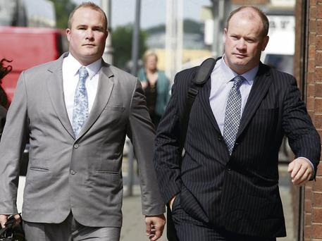 Former rugby international Frankie Sheahan, right, and his brother Joseph outside court.
