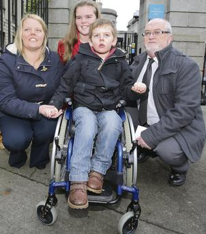 Mum Jean Gaffney and dad Thomas Hayes with son Dylan and daughter Shauna outside court.