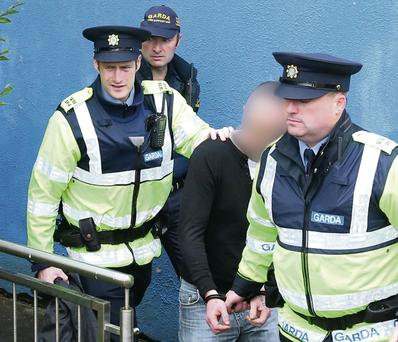 The 30-year-old man is accompanied by gardai as he leaves a courthouse last year