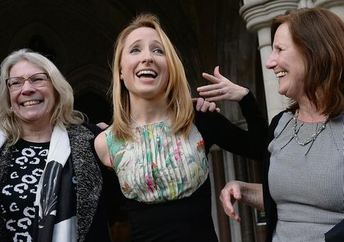 Beth Warren leaves court in London with her mother Georgina Hyde (right), and mother-in-law Helen Brewer. PA