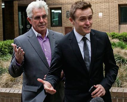 Public relations expert Max Clifford (left) interrupts a broadcast by Sky News reporter Tom Parmenter outside Southwark Crown Court in London on April 8