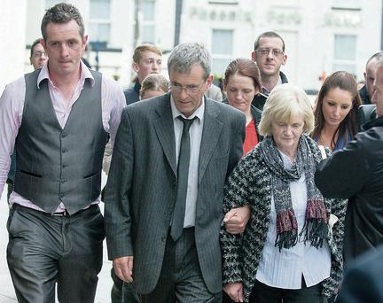The parents of Aoife Phelan, Michael and Betty Phelan, leaving the court with their son Daire after Robert Corbet was found guilty of her murder. Collins Courts