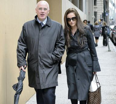 Lorraine and David Drumm leaving the Boston courthouse.