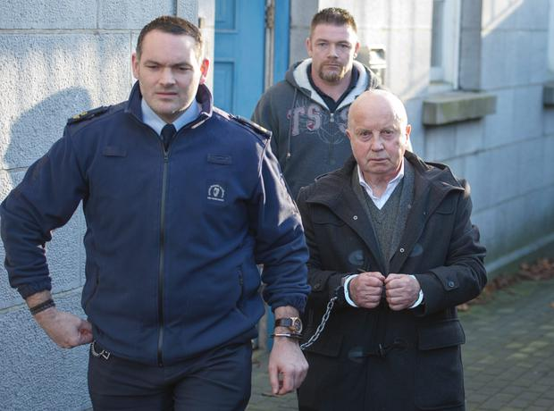 Patrick Barry is led away after being sentenced