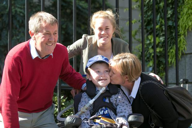 Matthew McGrath from Wexford leaving court with his family today and gets a kiss from his mother Catherine, also included are his father Alan and Sister Nicola