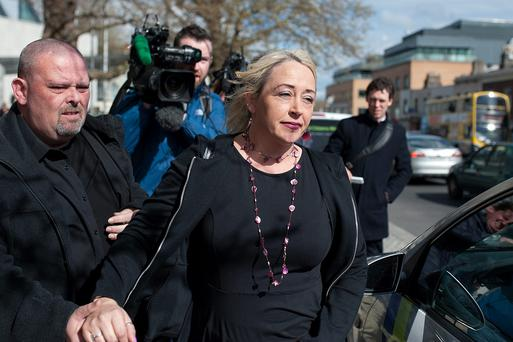 Gail O'Rorke leaves court with her husband Barry after she was cleared of aiding and abetting Bernadette Forde to take her own life