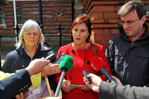 Joseph Duane's family (l-r) mother Nora, sister Marcia and brother Russell speak to the media at Cork District Court