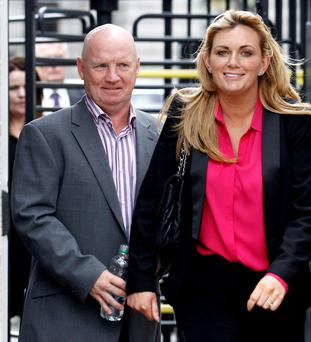 David Speedie leaves a Dublin court with his fiancee Margaret Gray