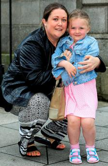 Clare Cullen with her daughter Lilly (4) after a court approved a settlement of €15,000 in damages