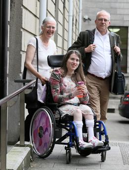 Emily Casey with her parents Dermot and Stephanie outside court yesterday