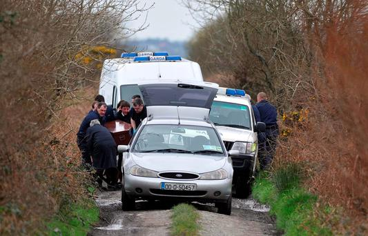 Gardai remove the remains of Brazilian national Bruno Lemes DeSouza (28) from Shroneowen Bog near Ballylongford in County Kerry in 2012