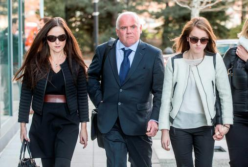David Drumm's wife Lorraine (left) leaves the John Joseph Moakley United States Courthouse in Boston yesterday