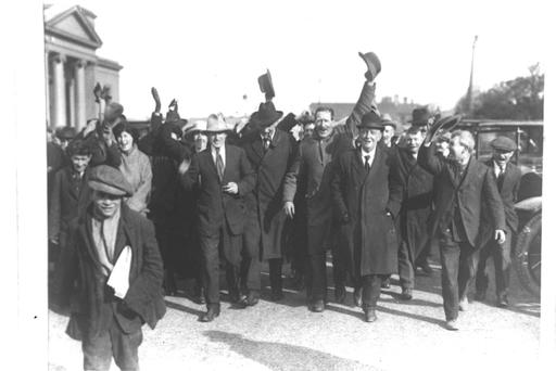 HERO'S WELCOME: Jim Larkin (centre) cuts a dour figure as he is greeted by supporters on his return from America