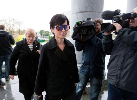 Cranberries singer Dolores O'Riordan arriving at Ennis Court yesterday with mother Eileen. Photo: Eamon Ward