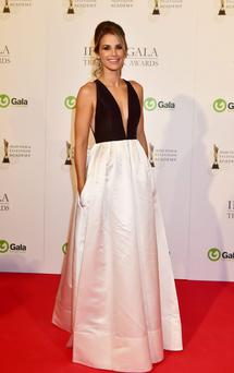 Vogue Williams made her first appearance at the 2015 IFTAs in a business on the bottom, party on top kind of dress.
