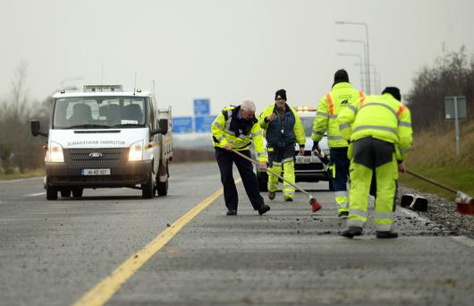 SCENE: A garda helps clear debris from the scene of the fatal crash in Co Westmeath. Picture: Caroline Quinn