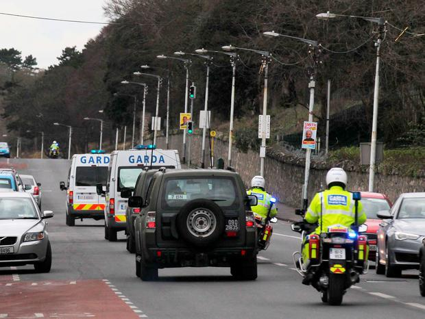 A prison van believed to be holding Thomas 'Slab' Murphy is escorted from the Special Criminal Court court after his sentencing. Photo: Collins Courts