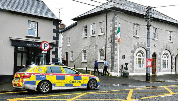 Armed gardaí outside the court in Virginia. Photo: Gerry Mooney