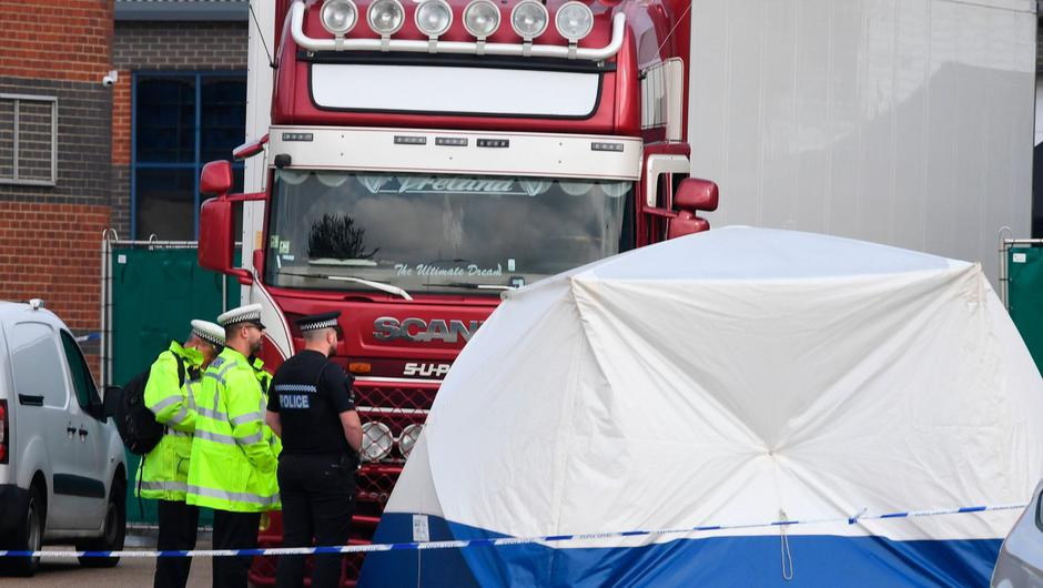 Police at the Waterglade Industrial Park in Grays, Essex, after 39 bodies were found inside a lorry container