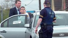 Nathan Killeen being arrested by gardai investigating the murder of Roy Collins in Ballinacurra-Weston, Limerick just hours after the fatal gun attack in 2009.