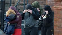 Bailed: Some of the accused and supporters leaving court. Photo: Michael Mac Sweeney/Cork Courts