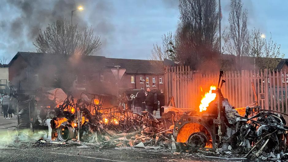 The wreckage of a Translink Metrobus on fire on the Shankill Road in Belfast yesterday. Photo: Liam McBurney/PA Wire