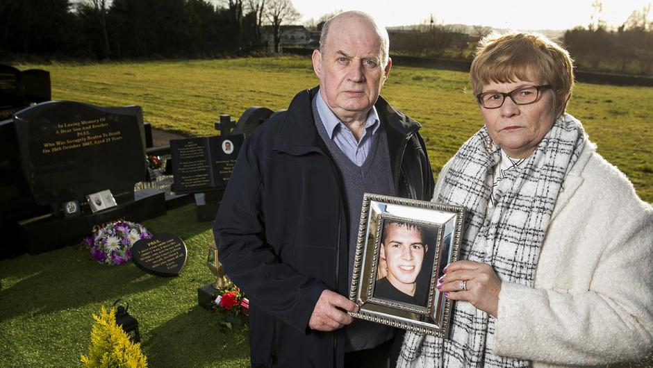 Stephen and Breege Quinn at their son Paul's graveside. Photo by: Liam McBurney/PA