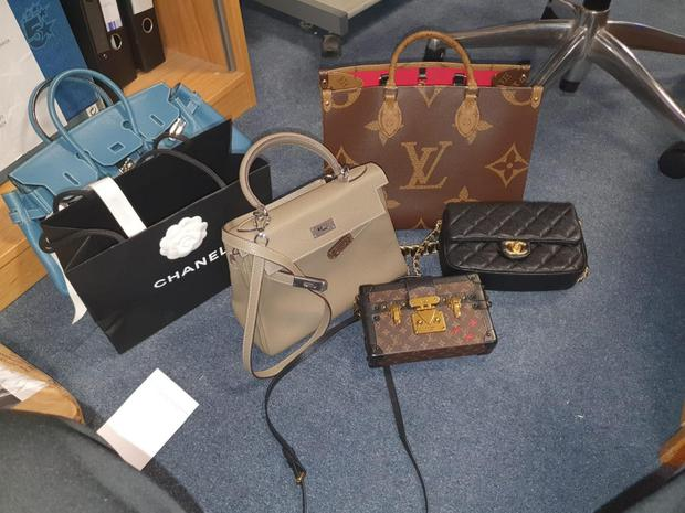 Designer bags seized in the raids. Picture:                   Gardaí