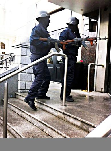 Masked and armed men disguised at Garda ERU                   members enter the Regency Hotel on the day of the                   attack