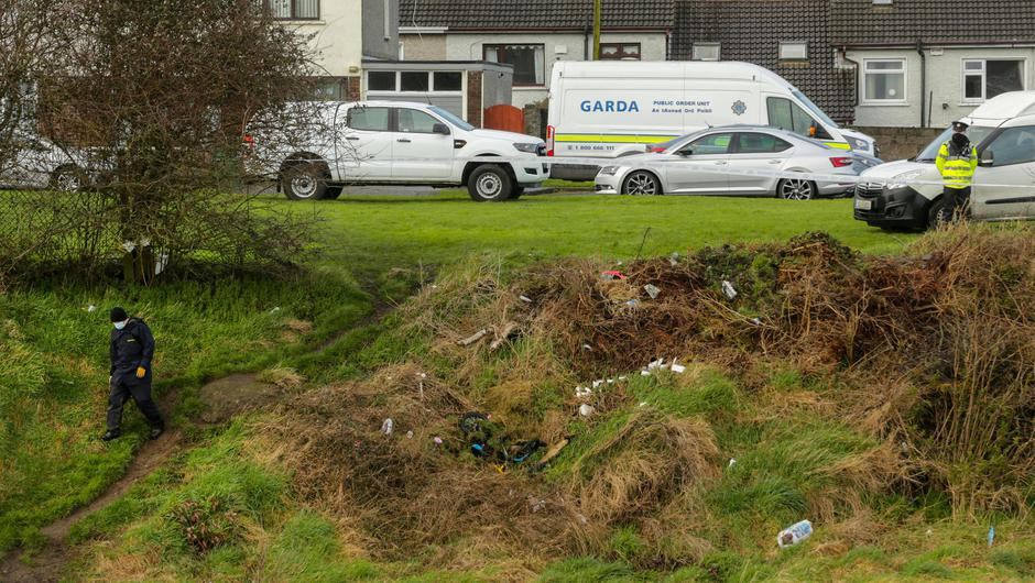 Gardai at the scene of waste ground next to the Rathmullen estate in Drogheda where they are searching for the remains of a missing teenage boy. PIC Gerry Mooney