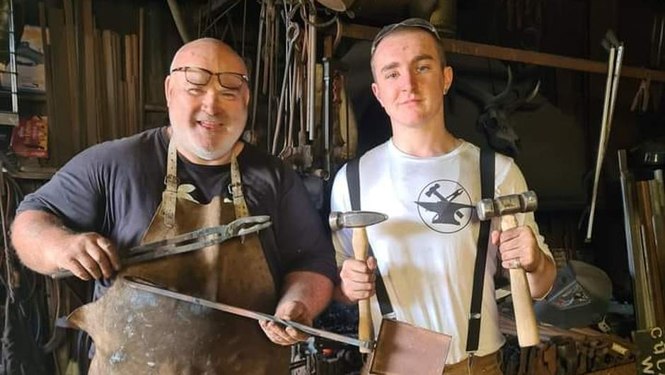 'A hard worker': Finín Liam Christie, a blacksmith from Gorey, with trainee Conor O'Brien, whom he described him as an ambitious young man who dreamed of travelling the world as a blacksmith