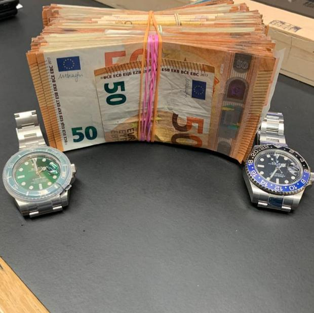 A large amount of cash and two watches thought to be Rolexes were seized