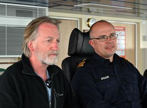 In charge: the ship's captain Lt Cmdr Phil Dicker, right, with Paul Williams