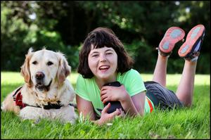 Charlotte Bratu-Breen with her autism assistance dog, Koda, at her home in Ballyboden in Dublin. Photo: Steve Humphreys