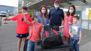 Return of non essential international travel Dublin Airport. Liam and Claire O'Connor with their children Aoibheann (15), Luke (12), James and Ryan (7). Picture; Gerry Mooney