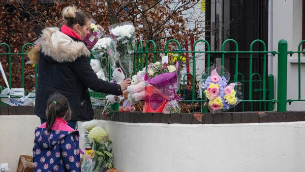 Locals pay their respects to the mother and children who died in a fire at Kilcronan Avenue in Clondalkin. Photo: Arthur Carron