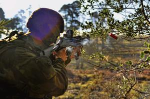 A Ranger holds a weapon during a training exercise.