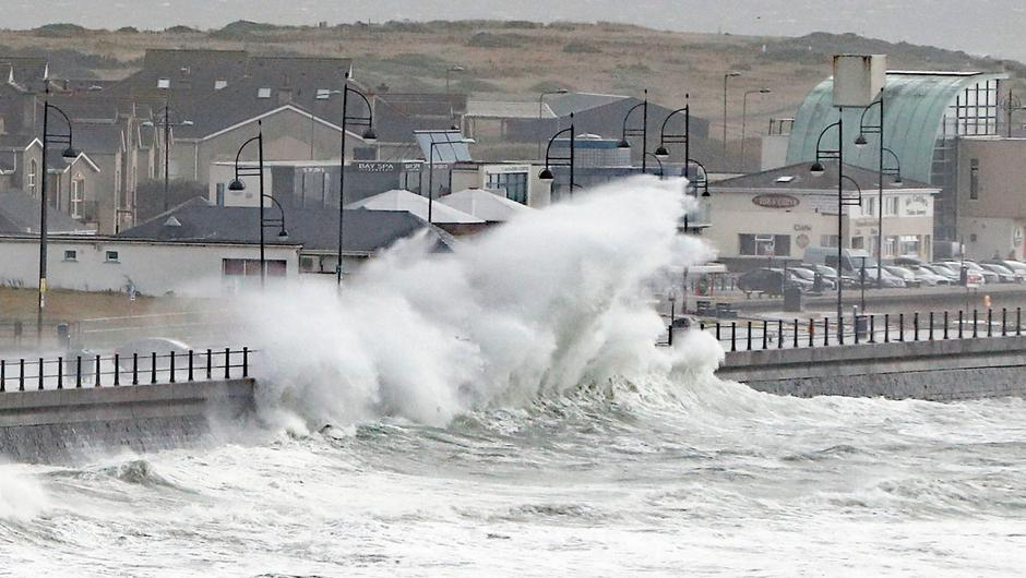 Waves crashing into the seafront at Tramore in County Waterford. Photo: Niall Carson/PA Wire