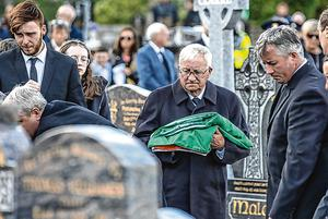 Marty Horkan, father of Detective Garda Colm Horkan at his graveside in St James's church, Charlestown, Co Mayo.