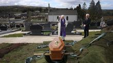 THE LOVED ONE: Parish Priest Gerard Alwill and undertaker Pat Blake at the graveside at St Ninnidh's cemetery in Derrylin yesterday, during the burial of Fermanagh's first Covid-19 victim, 72-year-old Anne Best. Photo: John McVitty
