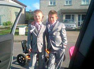 Twins Thomas and Paddy O'Driscoll in their communion suits.
