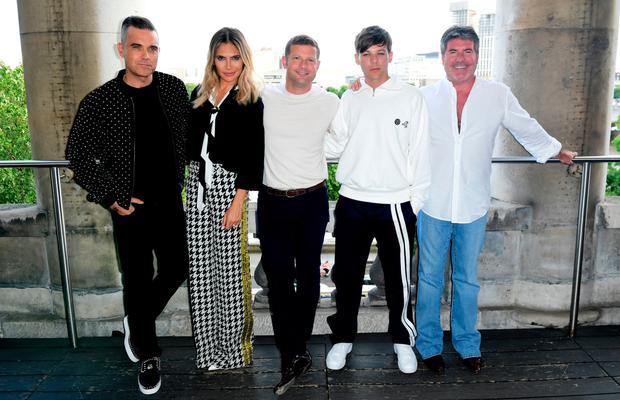 New panel: Robbie, Ayda, host Dermot O'Leary, Louis T and Simon Cowell. Photo: Ian West/PA Wire