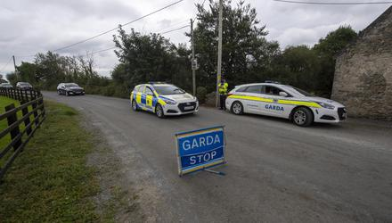 Garda cars and hearses at the scene of the suspected murder-suicide in Lixnaw, Co Kerry. Photo: Domnick Walsh © Eye Focus LTD